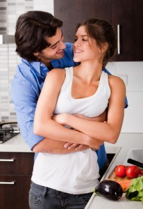 husband hold her wife and about to kiss